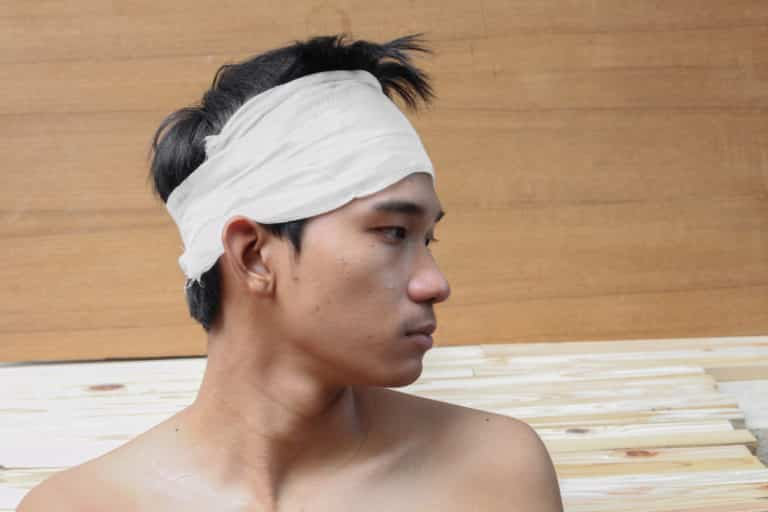 Young man with trauma of the head. by Medical bandage
