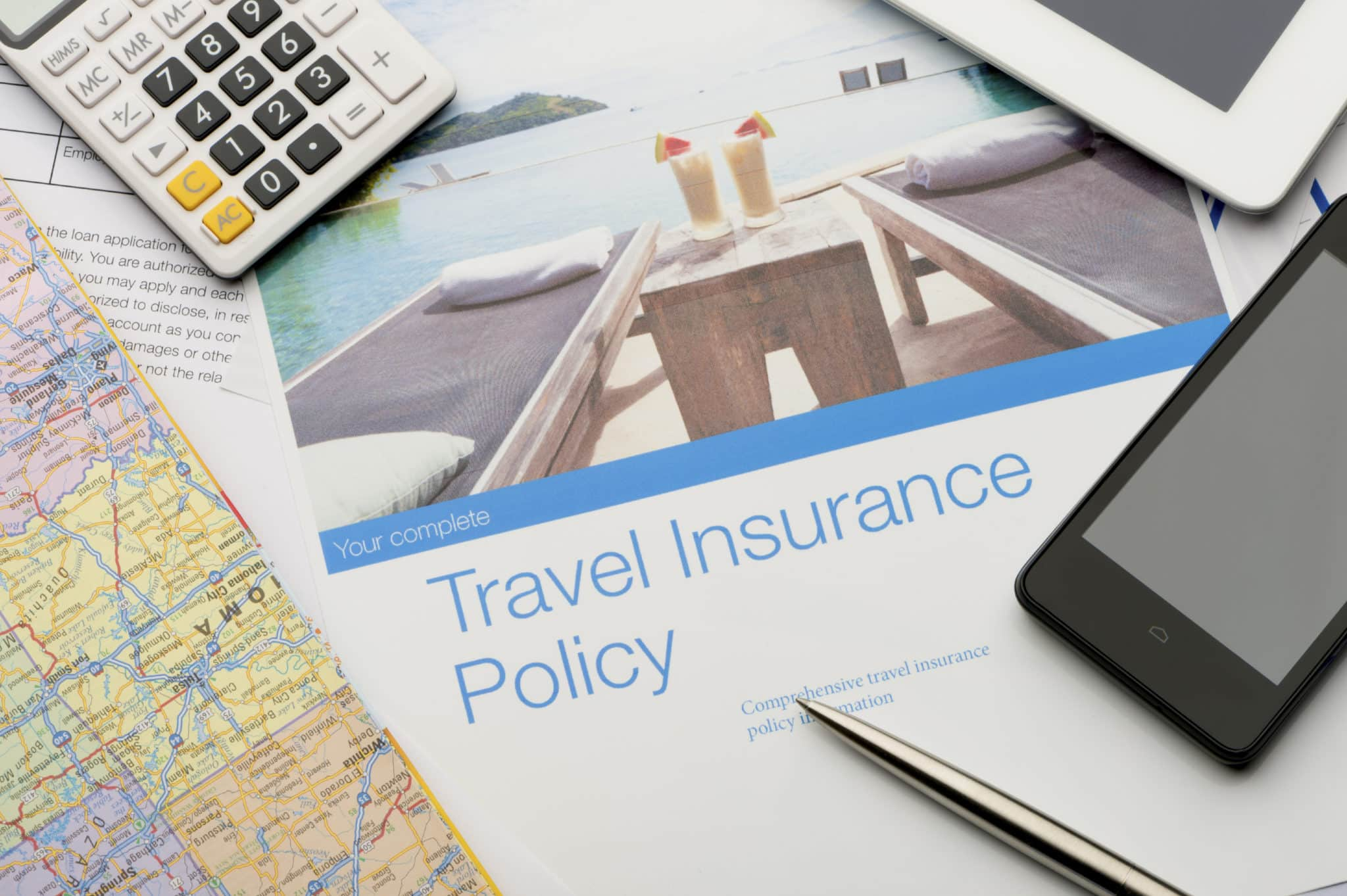 Travel insurance policy document with paperwork and technology. There ...