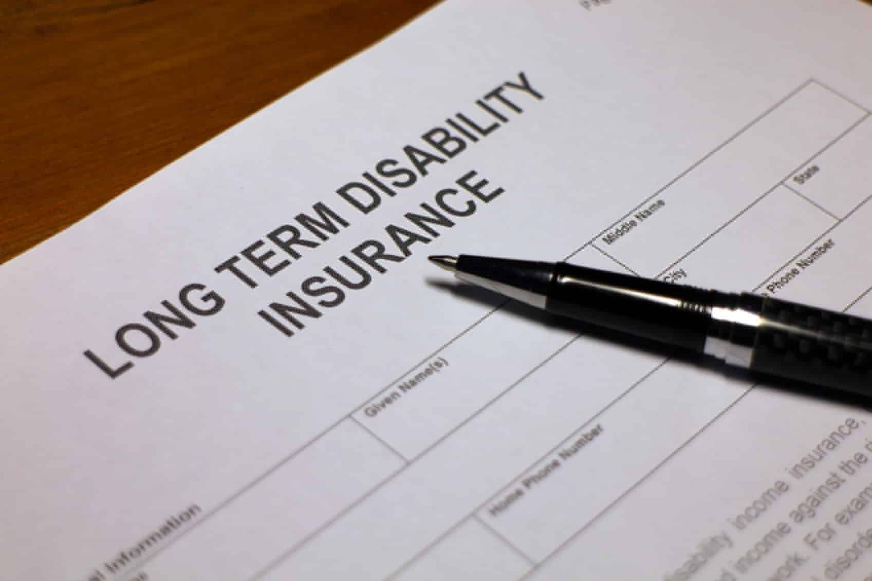 Someone filling out Long term Disability Insurance Application Form.