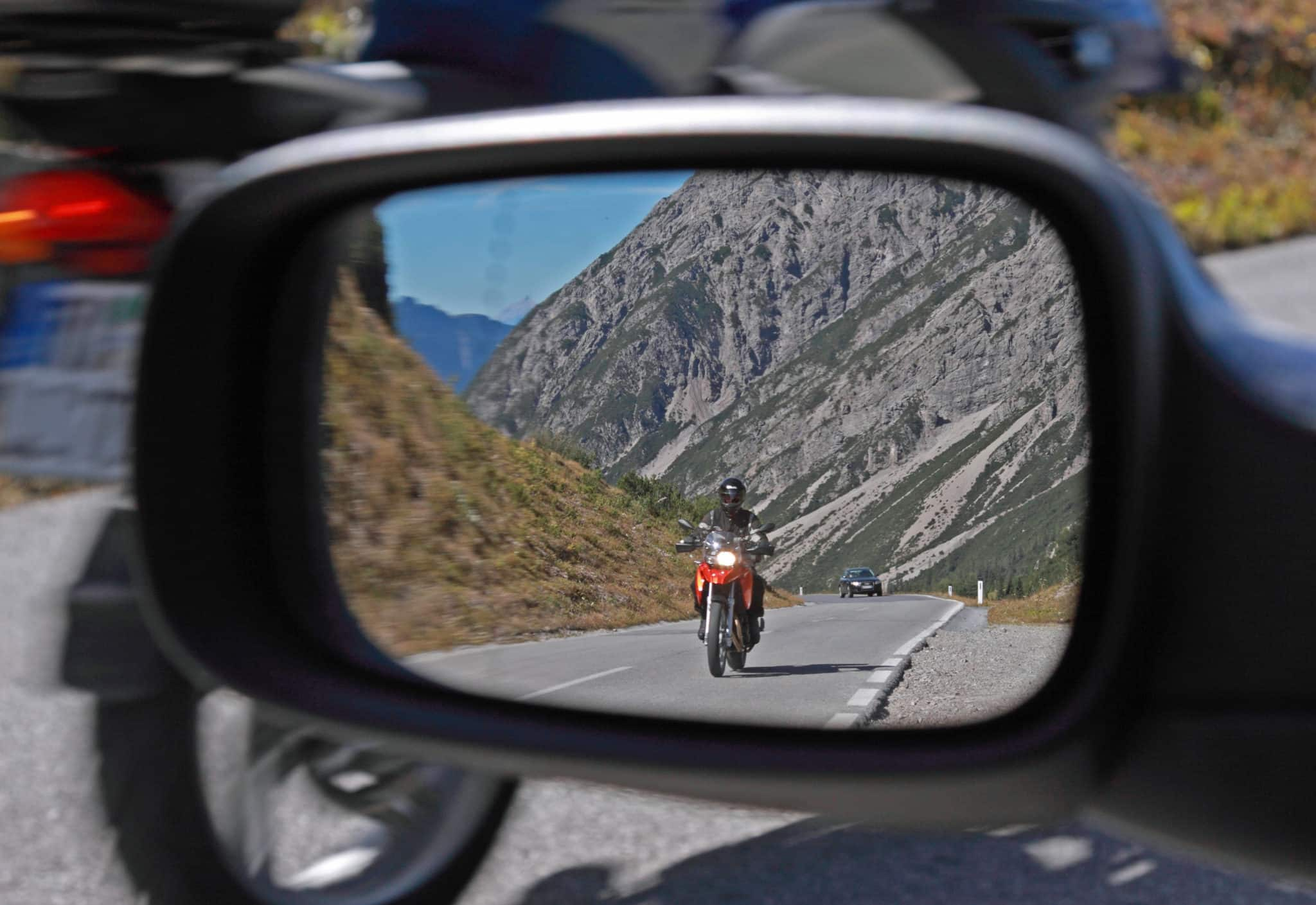 Motorcyclist in the rearview Mirror